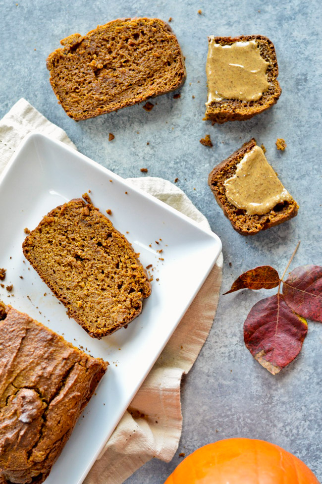 Moist Paleo Pumpkin Bread slices with almond butter over