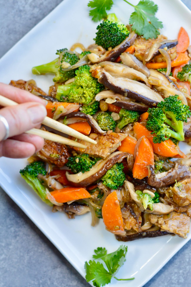 Asian Tempeh Broccoli Shiitake with chopsticks