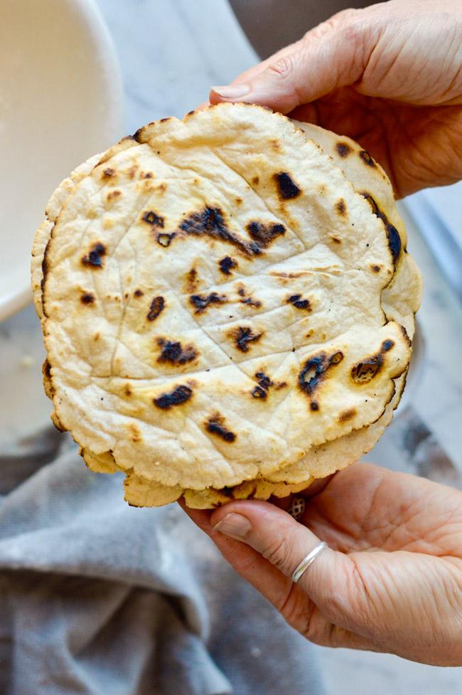 Paleo Cassava Tortillas being held in hand