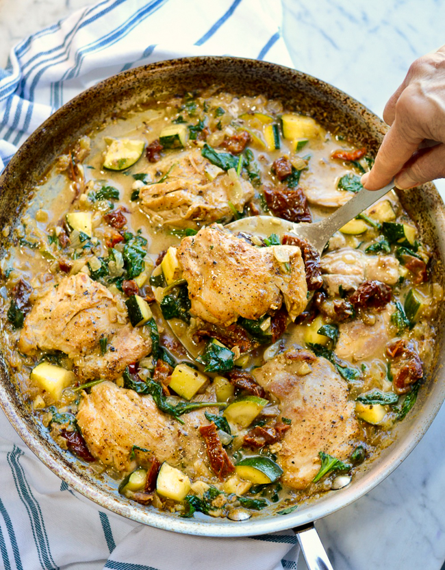 Creamy Italian Chicken and Vegetables pan and hand