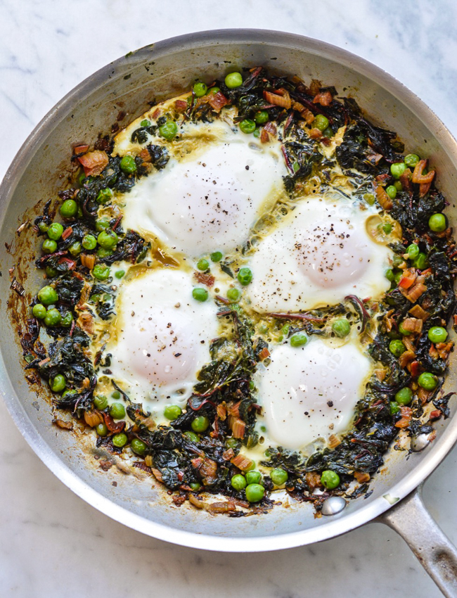 Skillet Greens with Molten Eggs Over