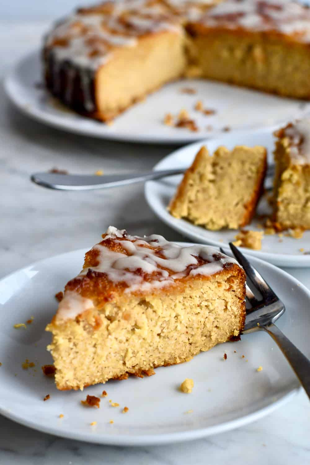 Honey Apple Cake on plate with cake behind