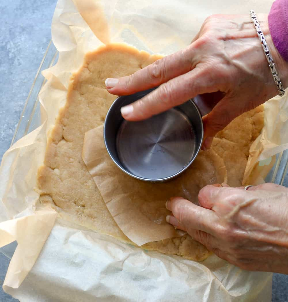 The Best Paleo Pecan Pie Bars with hands