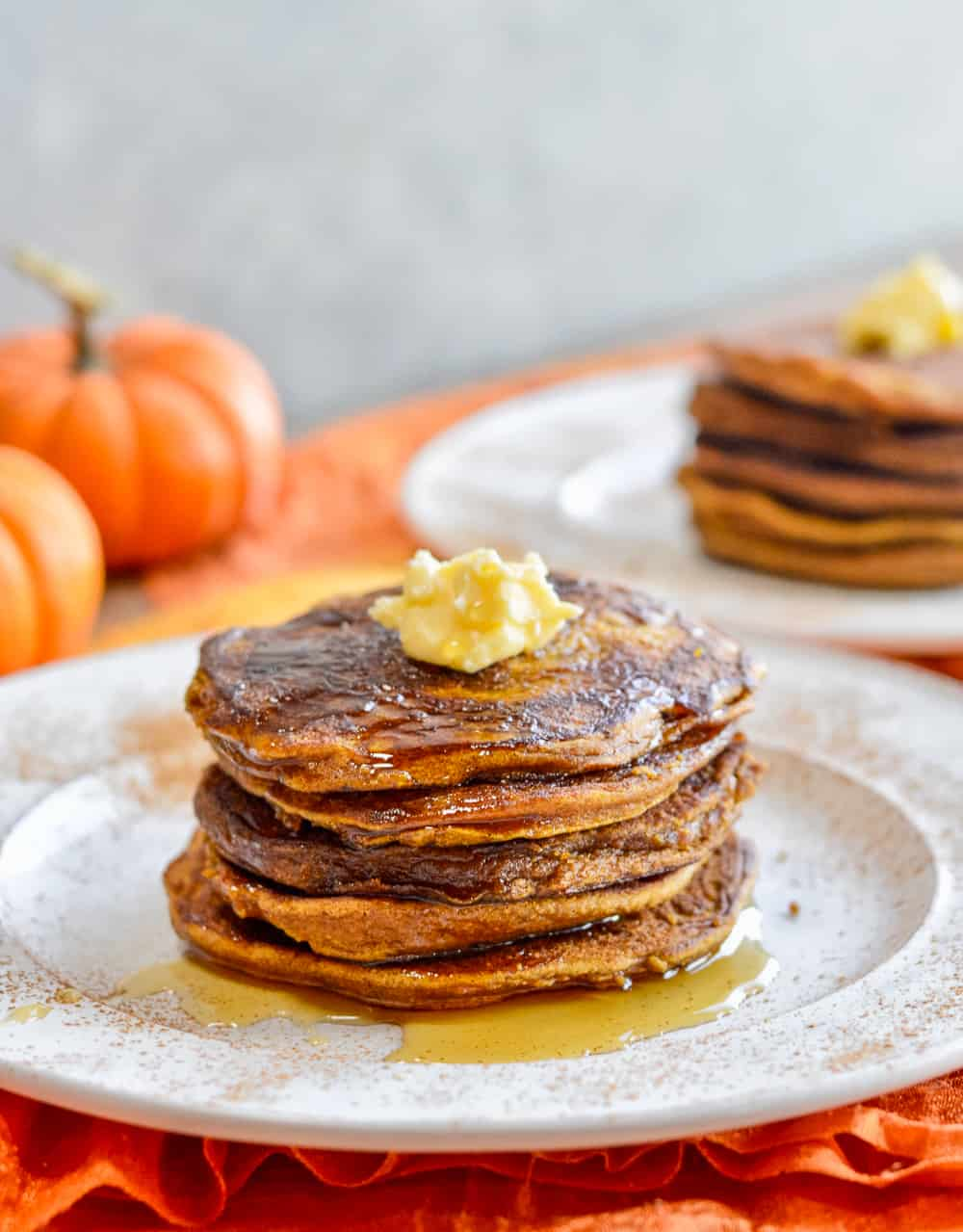 Paleo Pumpkin Pancakes on plate with maple syrup