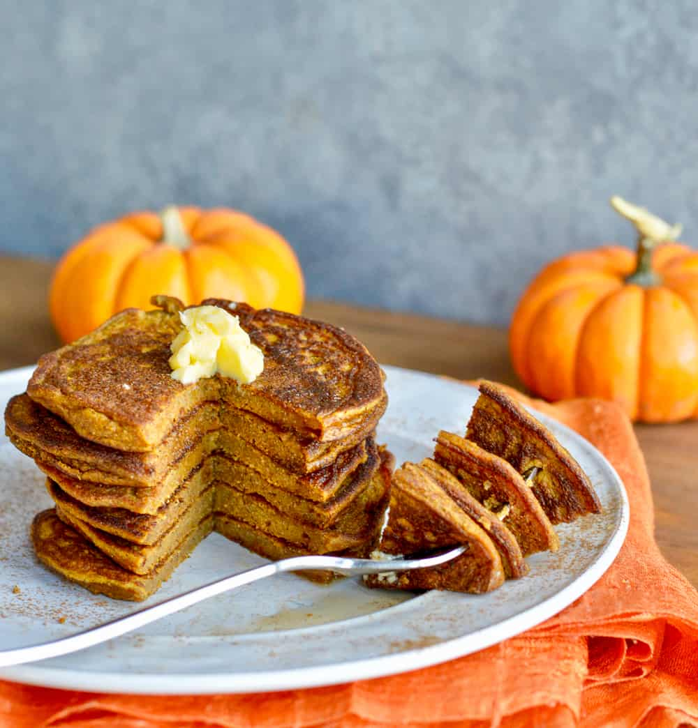 Paleo Pumpkin Pancakes (Nut Free) stacked with fork